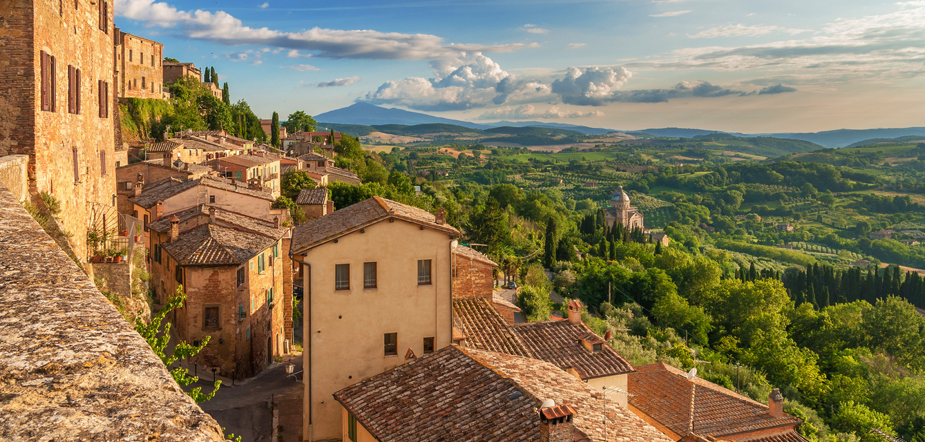 The charming city of Montepulciano is spread out along the ridge of a hillside, overlooking hectares of vineyards, the very same that produce the renowned red wine Vino Nobile.